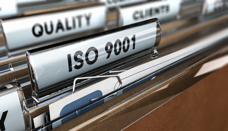 Close up on a file tab with the word ISO 9001, focus on the main text and blur effect. Concept image for illustration of Quality Standards